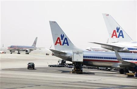 American Airlines aircraft stand on the tarmac at Los Angeles International Airport in Los Angeles April 20, 2012. REUTERS/Lucas Jackson