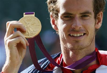 Britain's Andy Murray holds his gold medal during the presentation ceremony after winning the men's singles tennis gold medal match against Switzerland's Roger Federer at the All England Lawn Tennis Club during the London 2012 Olympic Games August 5, 2012. REUTERS/Stefan Wermuth