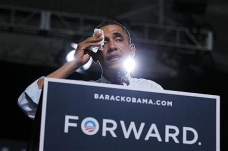 U.S. President Barack Obama wipes his brow in a hot gymnasium during an election campaign rally in Grand Junction, Colorado, August 8, 2012. Obama is in Colorado for a two-day campaign trip. REUTERS/Jason Reed