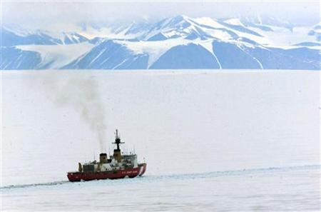 A United States Coast Guard icebreaker works in McMurdo Sound keeping a channel free for supply ships reaching the Antarctica's McMurdo Station and Scott Base.