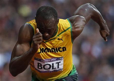Jamaica's Usain Bolt starts his men's 200m semi-final during the London 2012 Olympic Games at the Olympic Stadium August 8, 2012. REUTERS/Mark Blinch