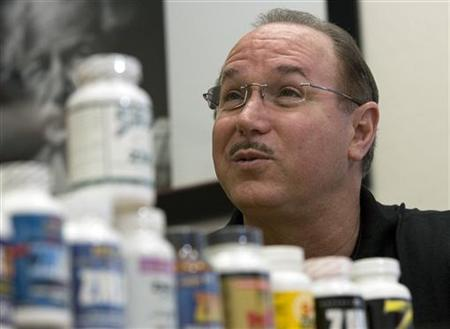 Victor Conte, owner of the now-defunct BALCO lab, talks next to bottles of his nutritional supplements in his office in Burlingame, California, in this March 20, 2007 file photo. REUTERS/Kimberly White/Files