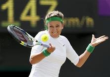 Belarus' Victoria Azarenka returns to Russia's Maria Kirilenko in their women's singles tennis bronze medal match at the All England Lawn Tennis Club during the London 2012 Olympic Games August 4, 2012. REUTERS/Stefan Wermuth