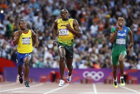 (L to R) Ecuador's Alex Quinonez, Jamaica's Usain Bolt and Brazil's Aldemir da Silva Junior compete in their men's 200m semi-final during the London 2012 Olympic Games at the Olympic Stadium August 8, 2012. REUTERS/Lucy Nicholson