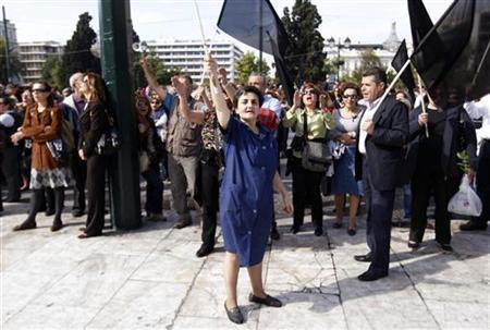 Civil servants take part in an anti-austerity rally in front of the parliament in Athens October 21, 2011. REUTERS/Yiorgos Karahalis