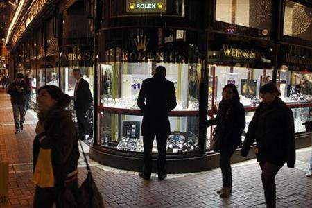 A man looks at a window display of jewellery on Grafton Street, Dublin, November 18, 2010. REUTERS/Cathal McNaughton