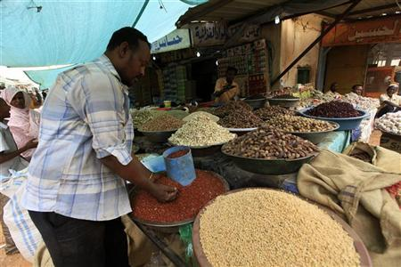 A man looks at food at Khartoum's central food market July 18, 2012. REUTERS/ Mohamed Nureldin Abdallah