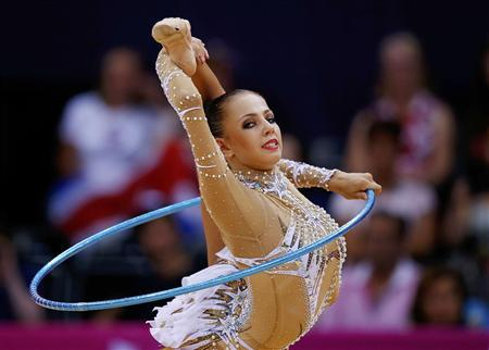 Russia's Daria Dmitrieva competes using the hoop in her individual all-around gymnastics qualification match at Wembley Arena during the London 2012 Olympic Games August 9, 2012. REUTERS/Brian Snyder