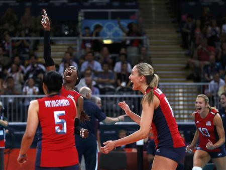 Destinee Hooker (L rear) celebrates with her team mates Tamari Miyashiro, Jordan Larson (2nd R) and Christa Harmotto (R) after winning their women's semi-final volleyball match against South Korea at Earls Court during the London 2012 Olympic Games August 9, 2012. REUTERS/Ivan Alvarado
