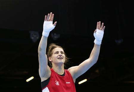 Ireland's Katie Taylor reacts as she is declared the winner over Russia's Sofya Ochigava after their Women's Light (60kg) gold medal boxing match at the London Olympic Games August 9, 2012. REUTERS/Murad Sezer