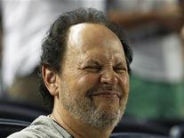 Actor Billy Crystal grimaces as he watches the New York Yankees take on the Toronto Blue Jays during their MLB American League baseball game at Yankee Stadium in New York, July 16, 2012. REUTERS/Adam Hunger