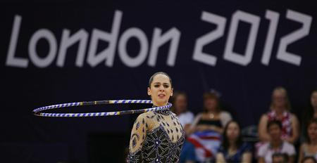 Egypt's Yasmine Mohmed Rostom competes using the hoop in her individual all-around gymnastics qualification match at Wembley Arena during the London 2012 Olympic Games August 9, 2012. REUTERS/Brian Snyder