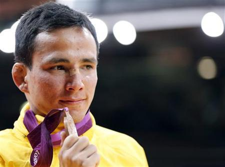 Brazil's Felipe Kitadai celebrates with his bronze B medal after the awards ceremony for the men's -60kg final judo match, at the London 2012 Olympic Games July 28, 2012. REUTERS/Kim Kyung-Hoon