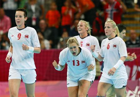 Norway's players celebrate their victory against South Korea in their women's semi-final match at the Basketball Arena during the London 2012 Olympic Games August 9, 2012. REUTERS/Adrees Latif