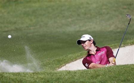 Rory McIlroy of Northern Ireland hits out of a sand trap on the 17th hole during the first round of the PGA Championship golf tournament at The Ocean Course on Kiawah Island, South Carolina, August 9, 2012. REUTERS/Matt Sullivan
