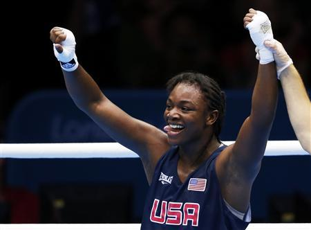 Claressa Shields of the U.S. celebrates after being declared the winner over Kazakhstan's Marina Volnova following their Women's Middle (75kg) semi-final boxing match at the London Olympic Games August 8, 2012. REUTERS/Murad Sezer