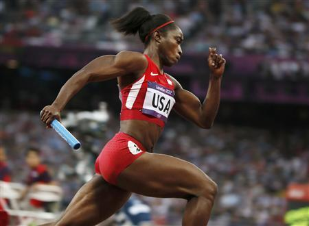 Tianna Madison of the U.S. competes in her women's 4x100m relay heat during the London 2012 Olympic Games at the Olympic Stadium August 9, 2012. REUTERS/Lucy Nicholson