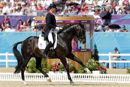Britain's Carl Hester riding Uthopia competes in the equestrian dressage individual grand prix freestyle event at the London 2012 Olympic Games in Greenwich Park August 9, 2012. REUTERS/Mike Hutchings