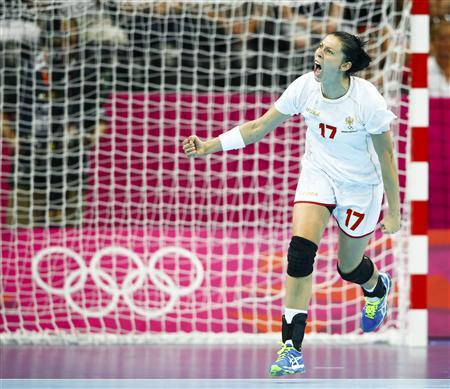 Montenegro's Bojana Popovic celebrates after scoring a goal against Spain during their women's semi-final match at the Basketball Arena during the London 2012 Olympic Games August 9, 2012. REUTERS/Marko Djurica
