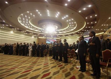 Participants stand during the handover ceremony of power from of the National Transitional Council (NTC) to members of the national congress in Tripoli, August 8, 2012. REUTERS/Esam Al-Fetori