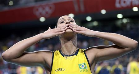 Brazil's Jaqueline Carvalho blows a kiss as she celebrates winning their women's semi-final volleyball match against Japan at Earls Court during the London 2012 Olympic Games August 9, 2012. REUTERS/Olivia Harris