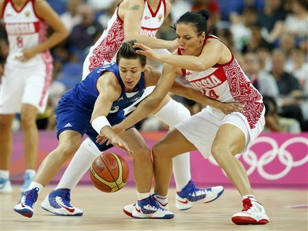 France's Celine Dumerc (L) and Russia's Natalya Zhedik go after the loose ball during their women's basketball semifinal match at the North Greenwich Arena during the London 2012 Olympic Games August 9, 2012. REUTERS/Mike Segar