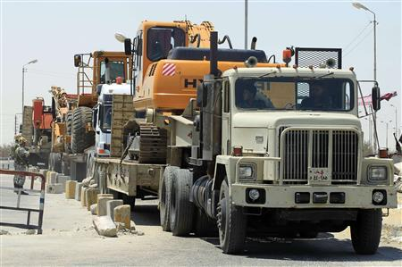 Egyptian army trucks, carrying heavy machinery to be used to destroy tunnels linking Egypt and the Gaza Strip, arrive at Rafah city, about 350 km (217 miles) northeast of Cairo August 9, 2012 . REUTERS/Mohamed Abd El Ghany