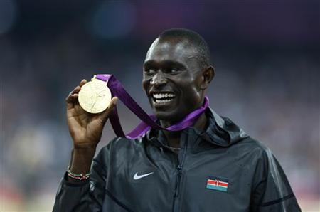 Gold medallist David Lekuta Rudisha of Kenya shows his medal during the presentation ceremony for the men's 800m event at the London 2012 Olympic Games at the Olympic Stadium August 9, 2012. REUTERS/Eddie Keogh