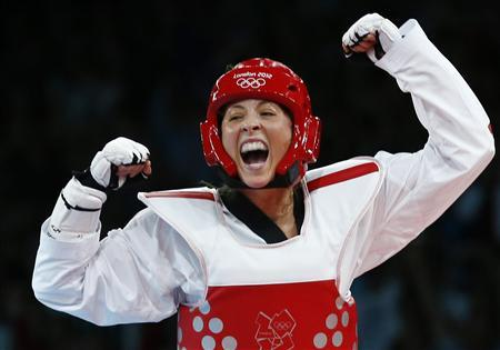 Britain's Jade Jones celebrates after winning against Taiwan's Li-Cheng Tseng in their women's -57kg semifinal taekwondo match at the ExCel venue during the London Olympic Games, August 9, 2012. REUTERS/Darren Staples