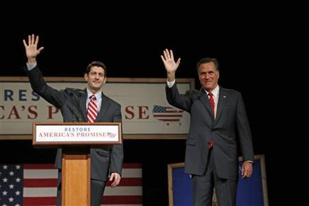 House Budget Chairman Paul Ryan (L) (R-WI) introduces Republican presidential candidate Mitt Romney (R) as he addresses supporters at Lawrence University during a campaign stop in Appleton, Wisconsin, March 30, 2012. REUTERS/Darren Hauck