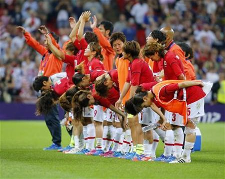 The Japan team wave and bow to the crowd after losing their women's soccer final gold medal match against the U.S. at Wembley Stadium during the London 2012 Olympic Games August 9, 2012. REUTERS/Mike Blake