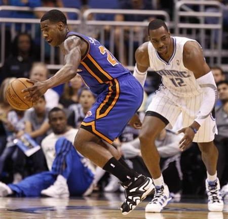 New York Knicks guard Iman Shumpert (L) steals the ball from Orlando Magic center Dwight Howard (R) during the first half of their NBA basketball game in Orlando, Florida April 5, 2012. REUTERS/Kevin Kolczynski