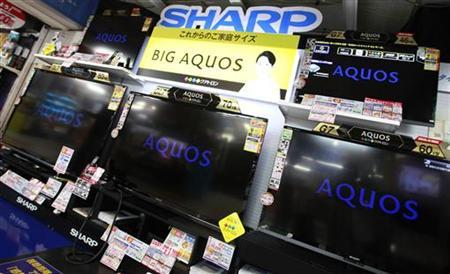 Sharp Corp's Aquos TVs are displayed at an electronics store in Tokyo August 8, 2012. REUTERS/Yuriko Nakao