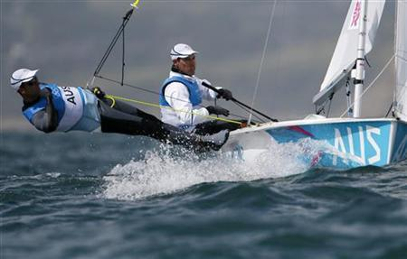 Australia's Mathew Belcher and Malcolm Page sail during the fifth race of the men's 470 sailing class at the London 2012 Olympic Games in Weymouth and Portland, southern England, August 4, 2012. REUTERS/Pascal Lauener