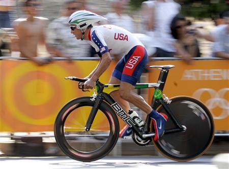 Tyler Hamilton of the U.S. takes the start in the men's 48-kilometre individual time trial event at Vouliagmeni near Athens, as part of the Athens 2004 Olympic Games in this August 18, 2004 file photo. American cyclist Tyler Hamilton will officially be stripped of his Athens 2004 Olympic gold medal on Friday as the International Olympic Committee (IOC) moves to close the case before the end of an eight-year statute of limitation, an IOC source told Reuters on August 9, 2012. REUTERS/Charles Platiau