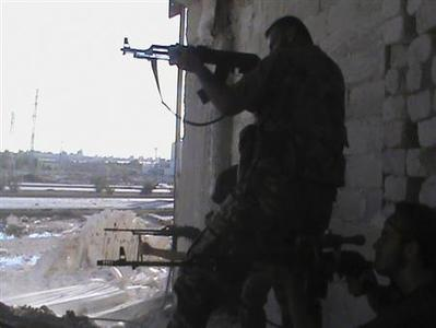 Free Syrian Army fighters clash with Syrian Army at Salah Edinne district, in the centre of Aleppo, August 7, 2012. REUTERS-Shaam News Network-Handout