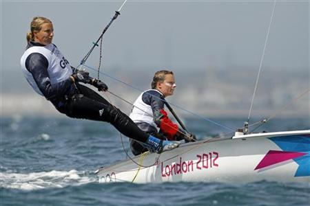 Britain's Hannah Mills and Saskia Clark sail during the first race of the women's 470 sailing class at the London 2012 Olympic Games in Weymouth and Portland, southern England, August 3, 2012. REUTERS/Benoit Tessier