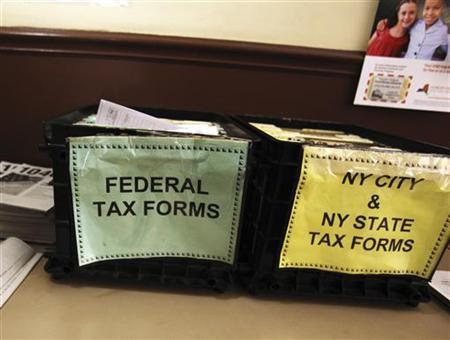 Crates filled with 2011 tax forms are seen at the 96th Street Public Library in New York April 17, 2012. REUTERS/Shannon Stapleton