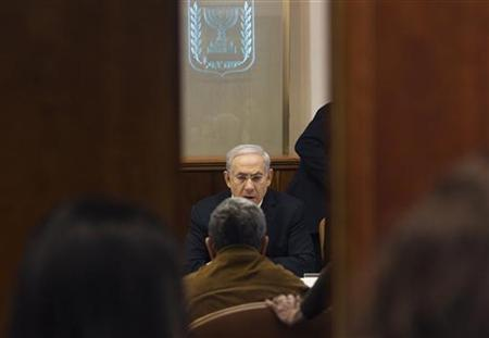 Israel's Prime Minister Benjamin Netanyahu sits across from Defence Minister Ehud Barak during the weekly cabinet meeting in Jerusalem March 11, 2012. REUTERS/Ronen Zvulun
