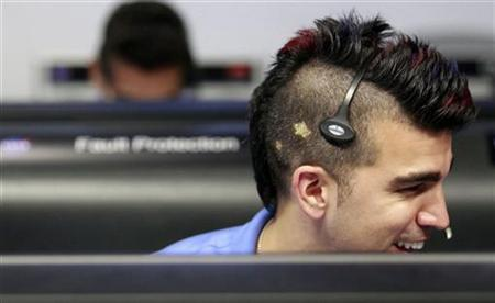 Activity lead Bobak Ferdowsi, who cuts his hair differently for each mission, works inside the Spaceflight Operations Facility for NASA's Mars Science Laboratory Curiosity rover at Jet Propulsion Laboratory in Pasadena, California August 5, 2012. REUTERS/Brian van der Brug/Pool