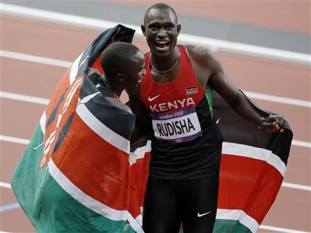 Kenya's David Rudisha (R) celebrates with teammate Timothy Kitum after winning the men's 800m in the Olympic Stadium during the London 2012 Olympic Games August 9, 2012. REUTERS/Luke MacGregor