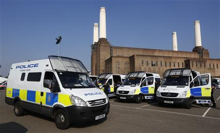 Police are stationed during the London 2012 Olympic Games at the Briefing and Deployment Centre set up for the Games at Battersea Power Station in London August 10, 2012. REUTERS/Luke MacGregor