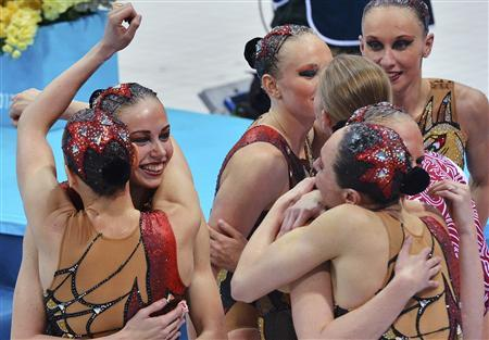Russia's team celebrate winning the gold medal in the synchronised swimming teams free routine final during the London 2012 Olympic Games at the Aquatics Centre August 10, 2012. REUTERS/Toby Melville