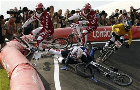 Latvia's Rihards Veide (back C) and Edzus Treimanis (L) crash with France's Quentin Caleyron (14) and Connor Fields of the U.S. as Australia's Khalen Young (R) rides by during the men's BMX semi-final run during the London 2012 Olympic Games at the BMX Track in the Olympic Park August 10, 2012. REUTERS/Paul Hanna