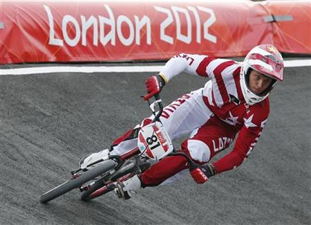 Latvia's Maris Strombergs competes in the men's BMX seeding run during the London 2012 Olympic Games at the BMX Track in the Olympic Park August 8, 2012. REUTERS/Cathal McNaughton