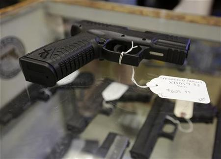 A hand gun, very similar to the gun used by alleged gunman Wade Michael Page, is seen at The Shooter Shop, where Page purchased the weapon, in West Allis, Wisconsin, August 7, 2012. REUTERS/John Gress