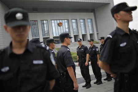 Police officers switch guard shifts outside the Hefei Intermediate People's Court in Hefei, Anhui Province August 10, 2012. REUTERS/Aly Song