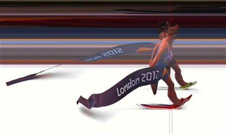 Nicola Spirig of Switzerland is seen defeating Lisa Norden of Sweden (front) in this photo finish handout image of the women's triathlon final of the London 2012 Olympic Games at Hyde Park August 4, 2012. REUTERS/Omega Ltd/Handout