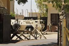 "Egyptian soldiers stand guard at Rafah border crossing between Egypt and southern Gaza Strip August 10, 2012. Egyptian military forces have captured six ""terrorists"" in the Sinai region after an attack on a police station earlier this week that killed 16 border guards, state television quoted a military source on Friday as saying. Hamas has ruled out suggestions that Palestinian gunmen took part in the Sinai massacre and have criticised Cairo for imposing ""collective punishment"" on the impoverished Mediterranean coastal enclave by sealing the frontier point. Egypt opened the Rafah border on Friday to allow the return of pilgrims from Saudi Arabia and those stranded on their way back to Gaza, the state news agency said, citing a high-ranking official, without outlining how long it would stay open. REUTERS/Ibraheem Abu Mustafa"