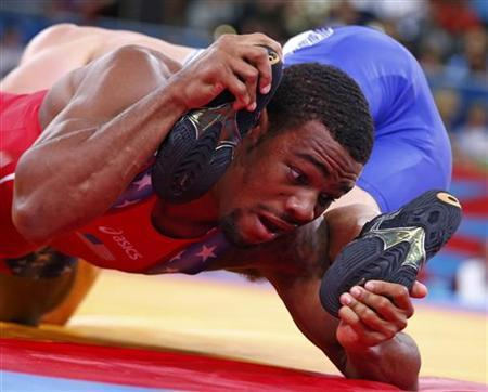 Jordan Ernest Burroughs of U.S. (in red) fights with Russia's Denis Tsargush on the semifinals of the Men's 74Kg Freestyle wrestling at the ExCel venue during the London 2012 Olympic Games August 10, 2012. REUTERS/Grigory Dukor